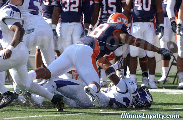 Erique Robertson takes down Northwestern's Sherrick McManis on a kickoff return