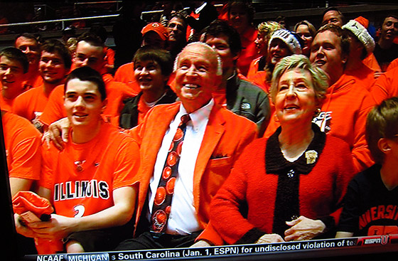 Lou Henson in the orange blazer